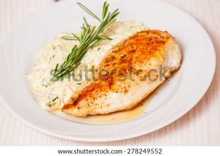 chicken breast with garnish - stock photo