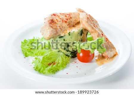 chicken breast with mashed potatoes, spinach and lettuce