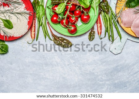 Chicken breast with  rice, fresh  delicious vegetables and ingredients for tasty cooking on rustic wooden background, top view,border. Diet or Sports nutrition concept - stock photo