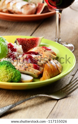 Chicken breast with rice, vegetables and fried pear - stock photo