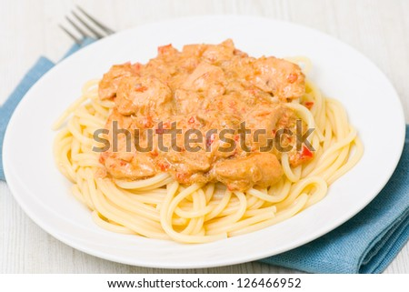 chicken breast with vegetables and mushrooms in a creamy sauce with pasta - stock photo