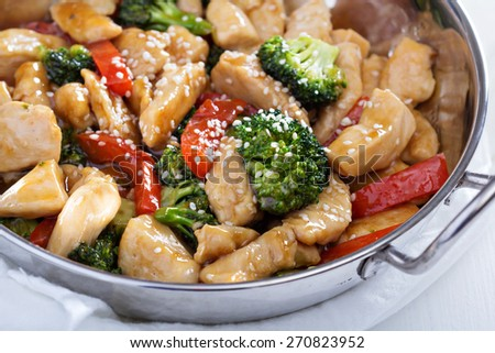 Chicken, broccoli and red pepper stir fry - stock photo