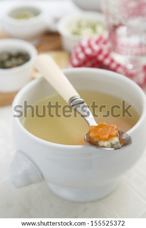 Chicken broth with carrot and pasta - stock photo