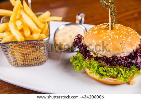 Chicken burger and french fries - stock photo