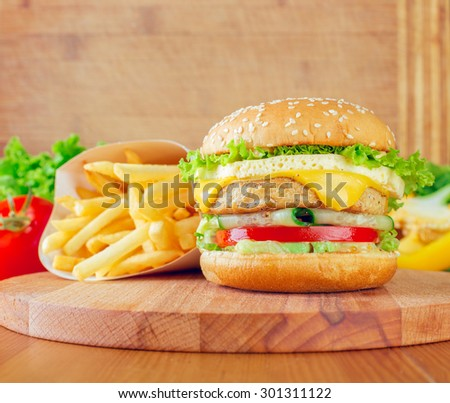 Chicken burger on wood stand - stock photo