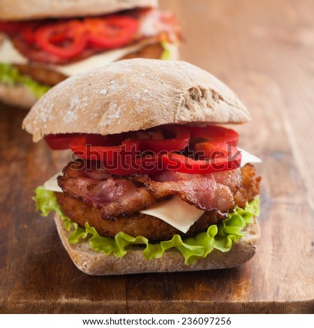 Chicken burger with bacon and pepper, selective focus - stock photo