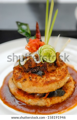 Chicken burger with sauce in the plate