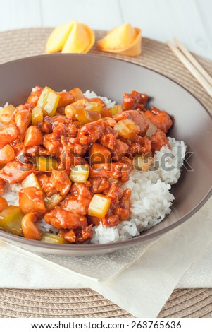 chicken cashew nuts  takeout in brown bowl and wooden chopstics - stock photo