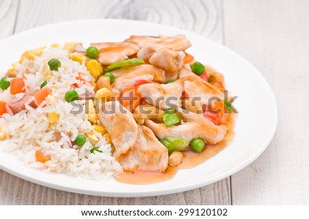 Chicken Cashew Rice dish over bright surface - stock photo