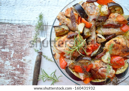 chicken casserole with chorizo, eggplant and potatoes with rosemary and thyme - stock photo