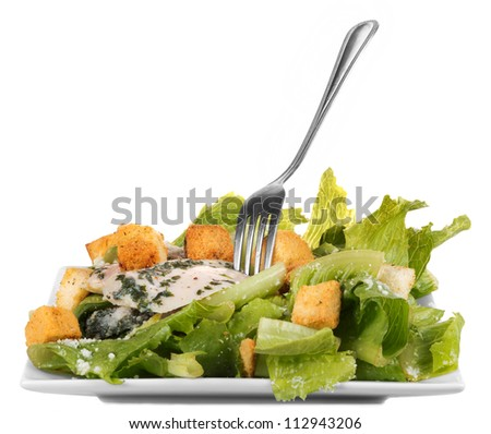 Chicken ceasar salad isolated on white background - stock photo