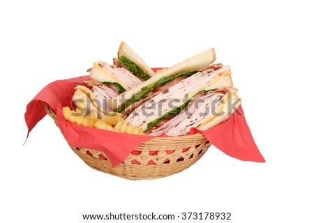 chicken club sandwich in wood basket - stock photo