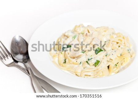 Chicken creamy alfredo sauce with white meat chicken, spinach & fettuccine pasta - stock photo