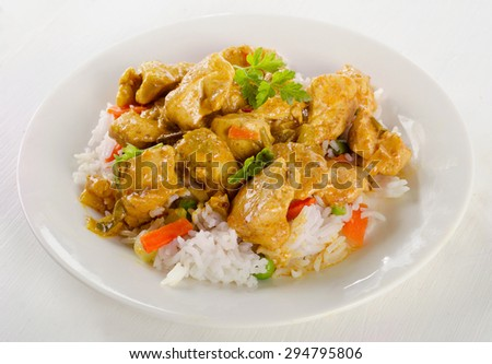 Chicken Curry and rice on a white plate. Selective focus - stock photo