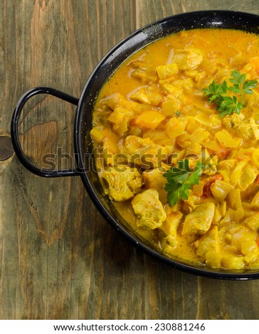 Chicken curry in  bowl on a wooden table. Selective focus - stock photo