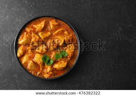 Chicken curry on dark background