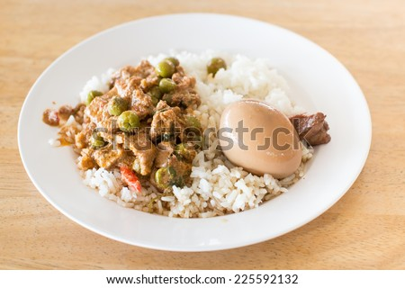 Chicken Curry with green peas and onions served and eggs boiled in the ...