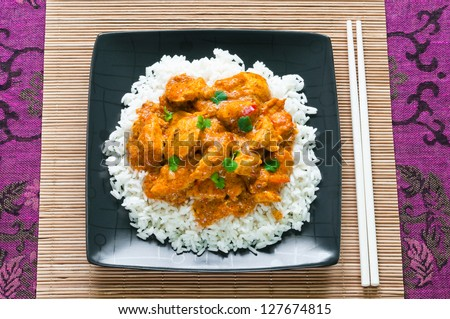 Chicken curry with rice and chopsticks from above