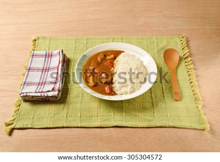 Chicken curry  with rice on a plate         - stock photo