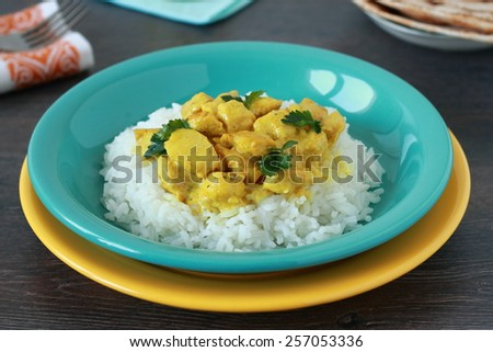 Chicken curry with rice  on wooden table - stock photo