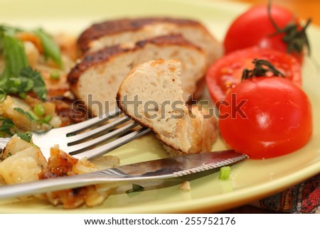 chicken cutlet with fried potato and fresh tomatoes