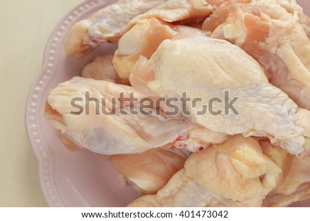 Chicken drumstick on dish - stock photo