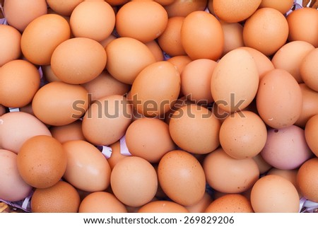 Chicken eggs in a basket isolate on white background . - stock photo