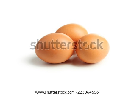 Chicken eggs isolated on white - stock photo