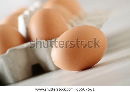 Chicken eggs on kitchen table - stock photo