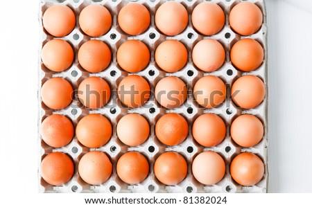 Chicken Eggs row pattern background - stock photo