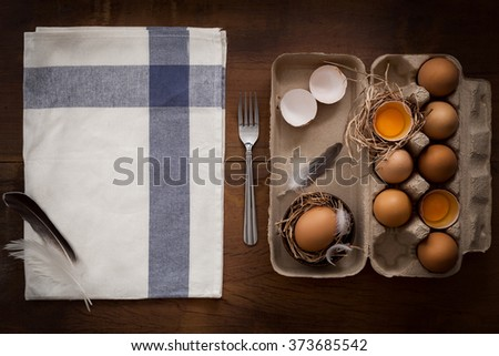 chicken eggs still life rustic with food stylish raw ingredient poultry healthy cholesterol protein vitamin natural rustic low key - stock photo