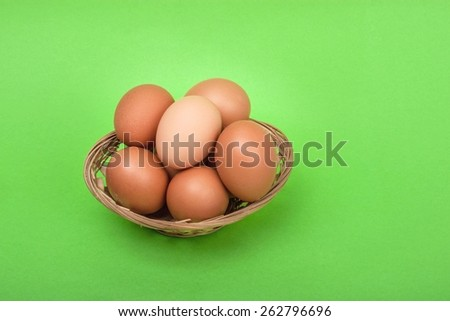 chicken eggs with green backgrounds to depict the freshness of the eggs. suitable for restaurants, poultry eggs, food for health, recipes and ingredients. - stock photo