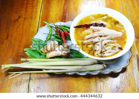 chicken feet with tamarind leaf spicy tom yam and mixed ingredient herb - stock photo