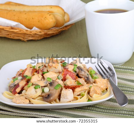 Chicken fettuccine alfredo with bread sticks and coffee