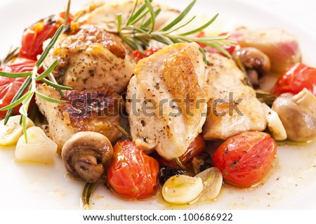 Chicken fillet with mushrooms and tomatos - stock photo