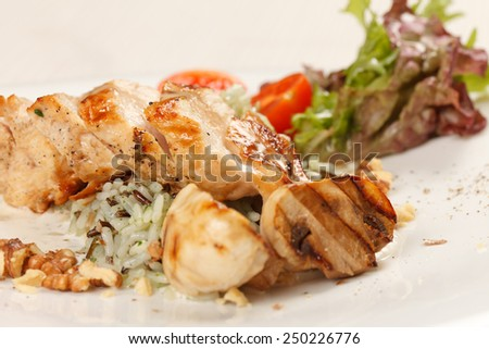 chicken fillet with vegetables and rice - stock photo