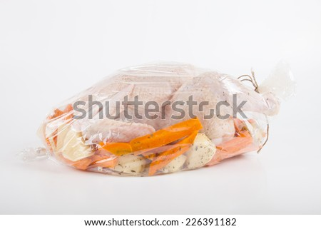 Chicken for frying with vegetables in a package  - stock photo