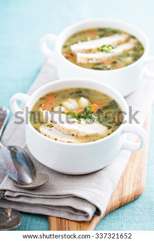 Chicken gnocchi soup with vegetables in small bowls