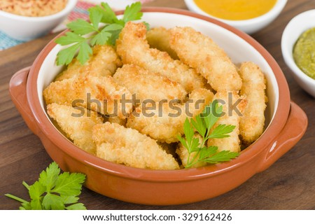 Chicken Goujons- Breaded and deep fried chicken pieces. - stock photo