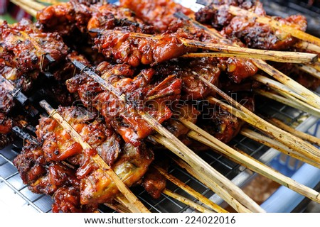 Chicken grilled on charcoal. - stock photo