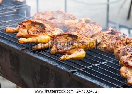 Chicken grilled over a charcoal fire