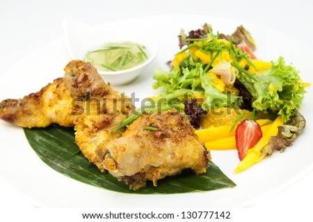 chicken in curry with salad and sauce on a white background in restaurant