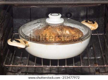 chicken in the oven - stock photo