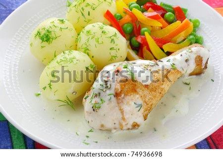 Chicken leg with vegetables and sauce