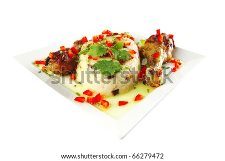 chicken legs served with vegetables on porcelain plate