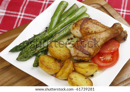 Chicken legs with vegetables - stock photo