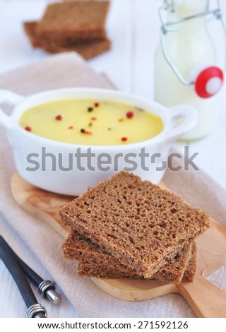 Chicken liver pate on bread and in plate - stock photo