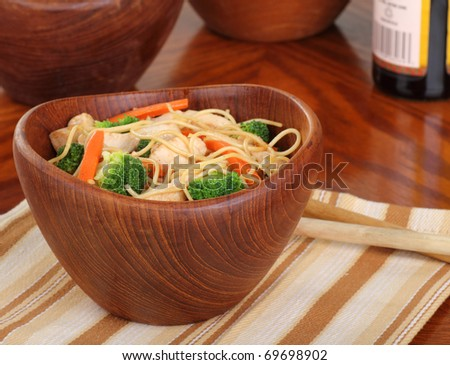 Chicken lo mein with carrots and broccoli in a bowl - stock photo
