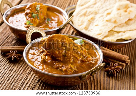 chicken madras with naad bread - stock photo