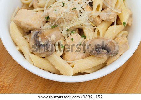 Chicken Marsala with penne pasta - stock photo